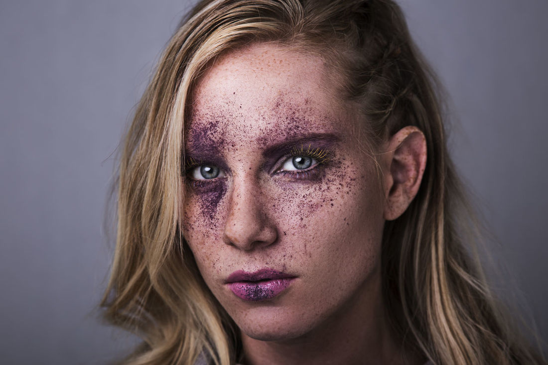 Adult Adults Only Beaten Up Beautiful Woman Blond Hair Bruise Close-up Day Depression - Sadness Gray Background Headshot Human Body Part Human Face Looking At Camera Make Up One Person One Woman Only One Young Woman Only Only Women People Portrait Real People Studio Shot Young Adult Young Women