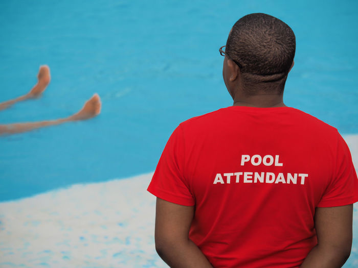 Adult Beach Close-up Day Men One Person Outdoors People Pool Pool Attendant Rear View Red Safety Sea Swim Swimmer Water