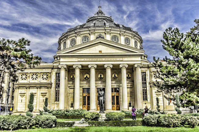 Image with Romanian Athenaeum Romanian Athenaeum Architecture Athenaeum Athenaeum Centre Building Exterior Built Structure City Cloud - Sky Day Dome Government History Low Angle View No People Outdoors Pediment Sculpture Sky Tourism Travel Travel Destinations Tree