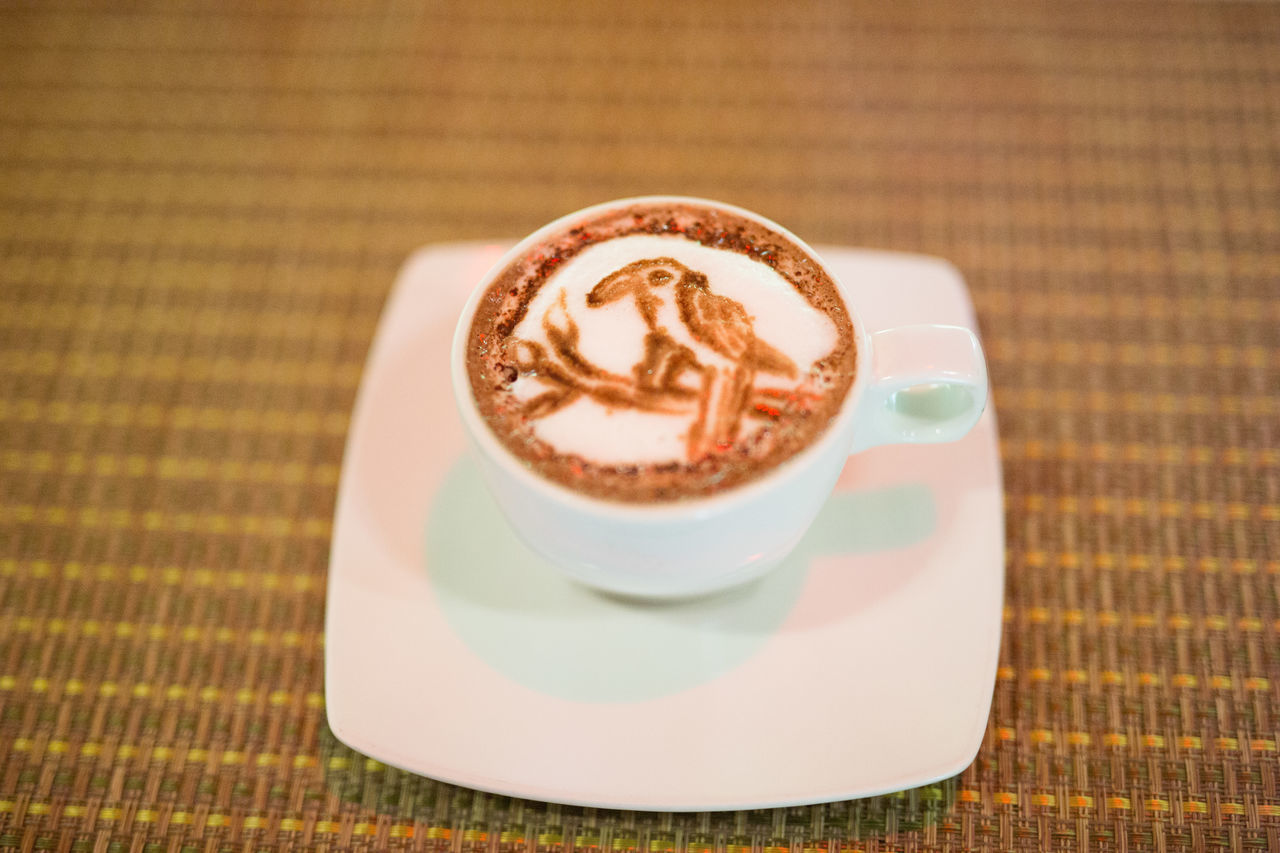 coffee cup, coffee - drink, saucer, frothy drink, drink, refreshment, froth art, cappuccino, food and drink, table, no people, pattern, indoors, close-up, freshness, latte, day