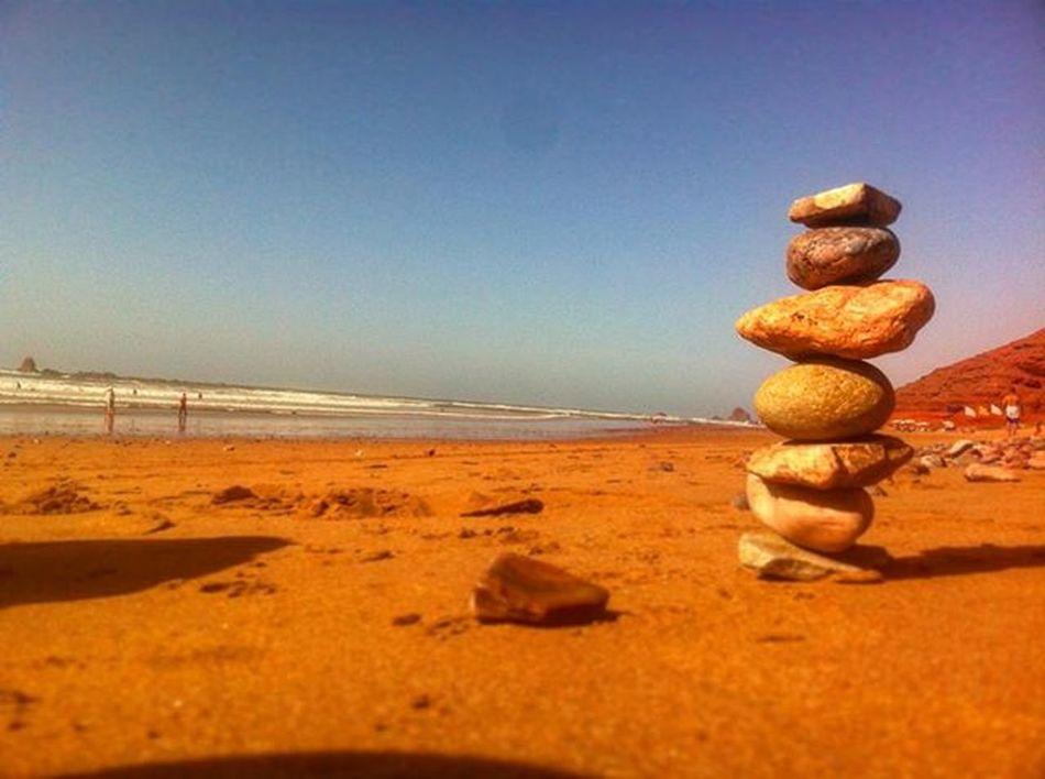 Piling rocks. Morroco Legzira