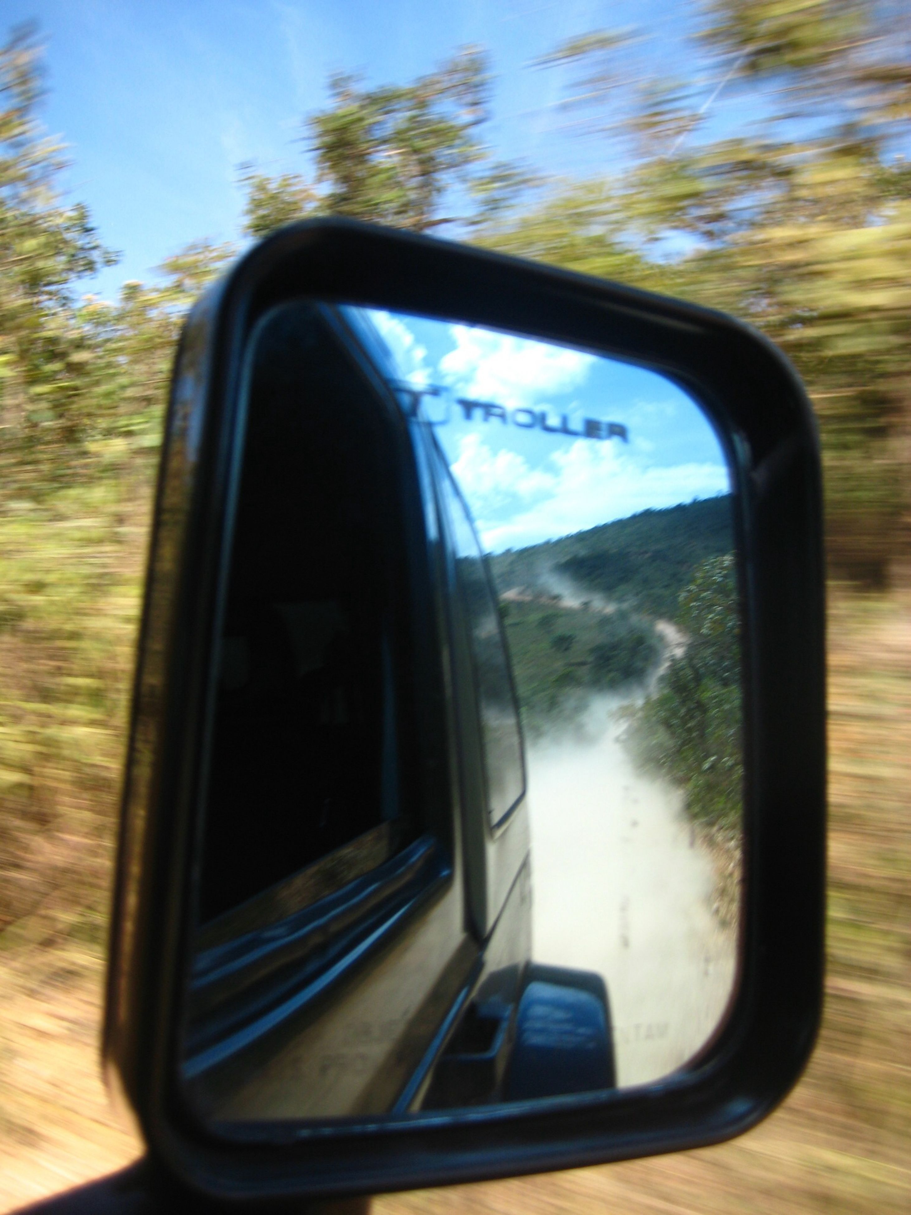 transportation, mode of transport, car, side-view mirror, land vehicle, reflection, vehicle interior, glass - material, transparent, window, travel, car interior, sky, part of, close-up, road, windshield, mirror, cropped, rear view mirror