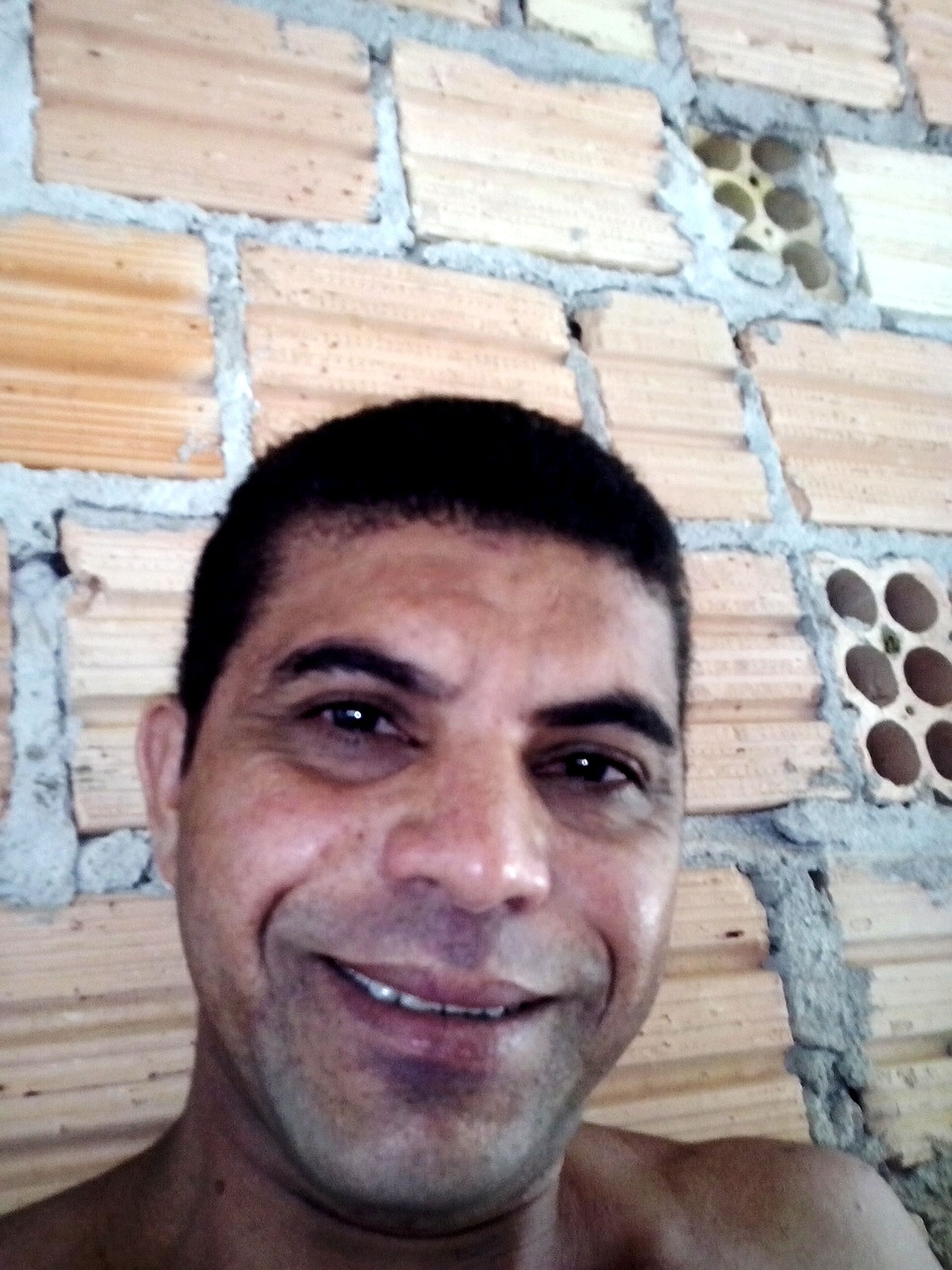 looking at camera, portrait, close-up, front view, wall - building feature, person, wood - material, headshot, indoors, lifestyles, wooden, young men, smiling, day, young adult, focus on foreground, built structure, architecture