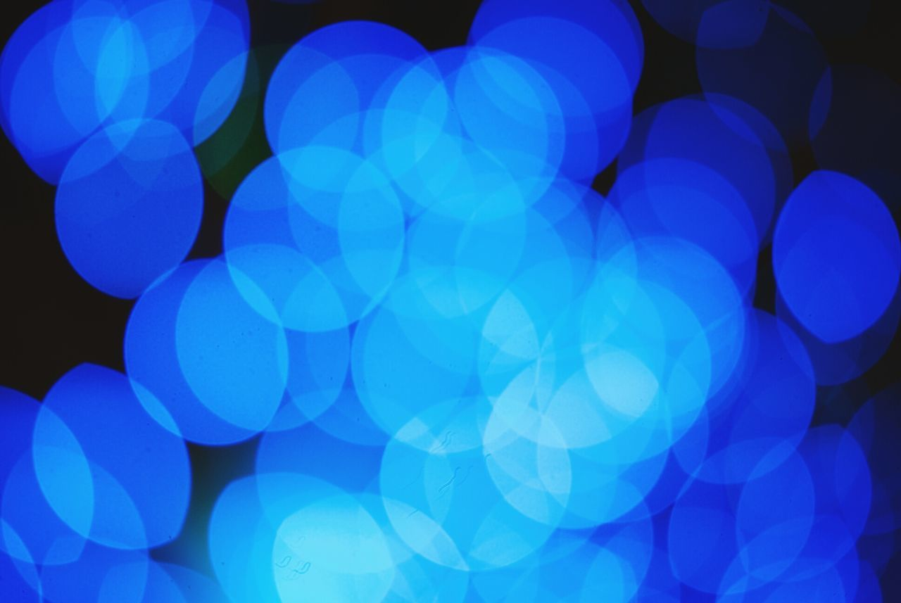Blue Bokeh Blue Abstract Backgrounds Pattern Multi Colored No People Illuminated Defocused Night Close-up Outdoors Bokeh Photography Orbs Glowing Blue Tones Circles Shapes Shapes And Forms Light Shapes Defocus