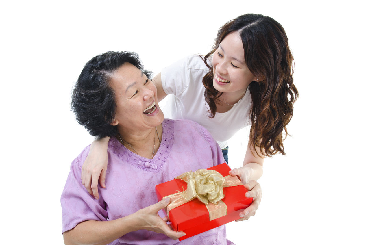 Adult Adults Only Archival Birthday Birthday Present Cheerful Females Gift Giving Grandparent Happiness Husband Love Mature Adult Mature Women People Pink Color Senior Adult Smiling Studio Shot Togetherness Two People White Background Wife Women