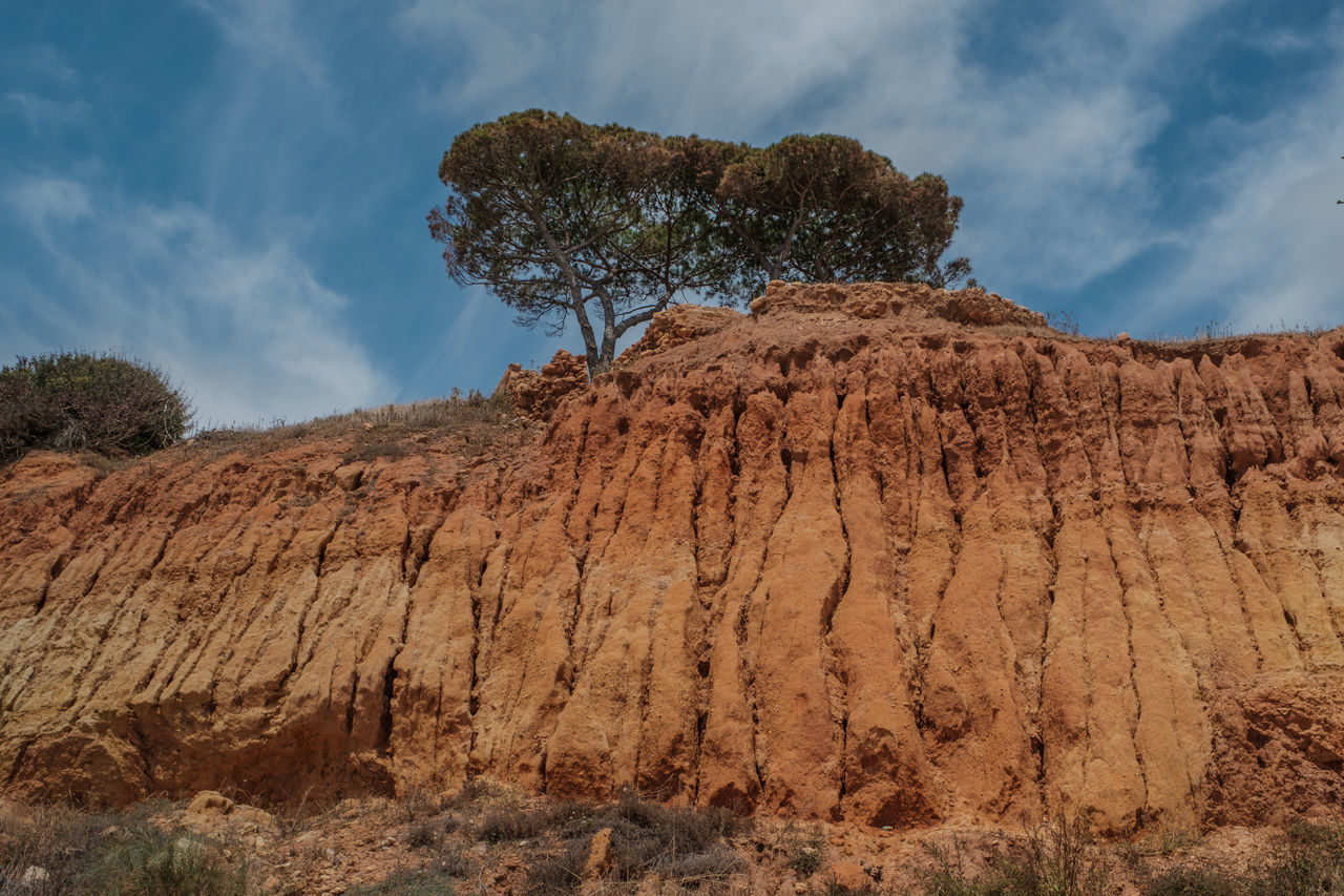 Algarve, Portugal Cloud - Sky Desert Geology Low Angle View Mountain Nature No People Outdoors Physical Geography Rock - Object Rock Formation Sky Tree