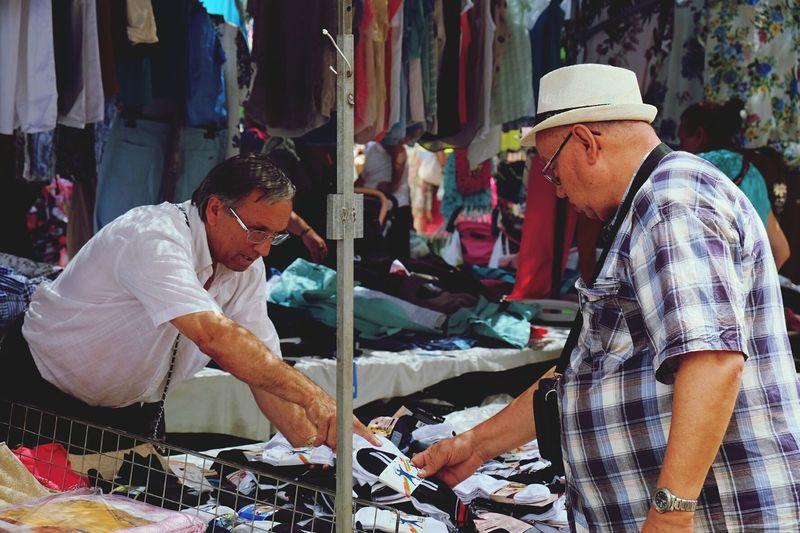 Tourist buying cheap socks for his flip flops