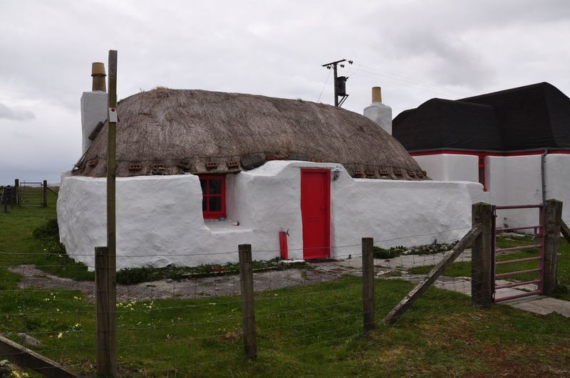 Hebridean Black House. These houses were constructed of a double dry stone wall using just earth to fill in the gaps. Some had flagstones on the floor, but mostly was again just the earth used on the floor. There was a fire in the middle of the room Scotland This Is My Country