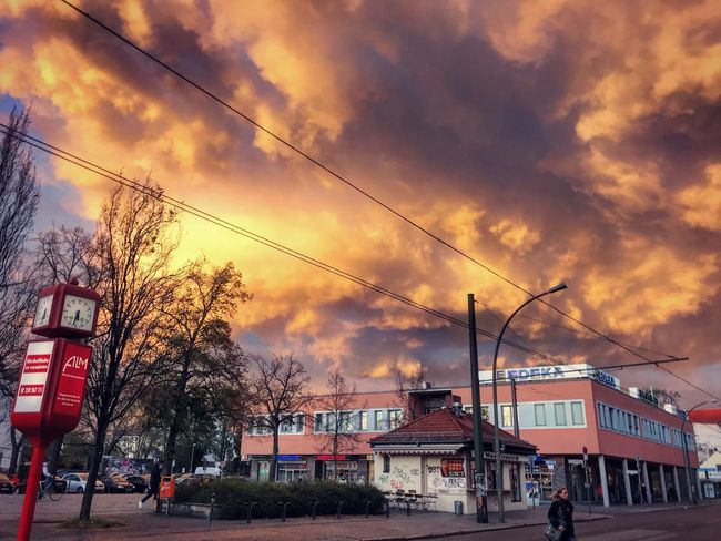 Architecture Building Exterior Built Structure Car City Cloud - Sky Day Large Group Of People Nature Outdoors People Real People Road Sky Sunset