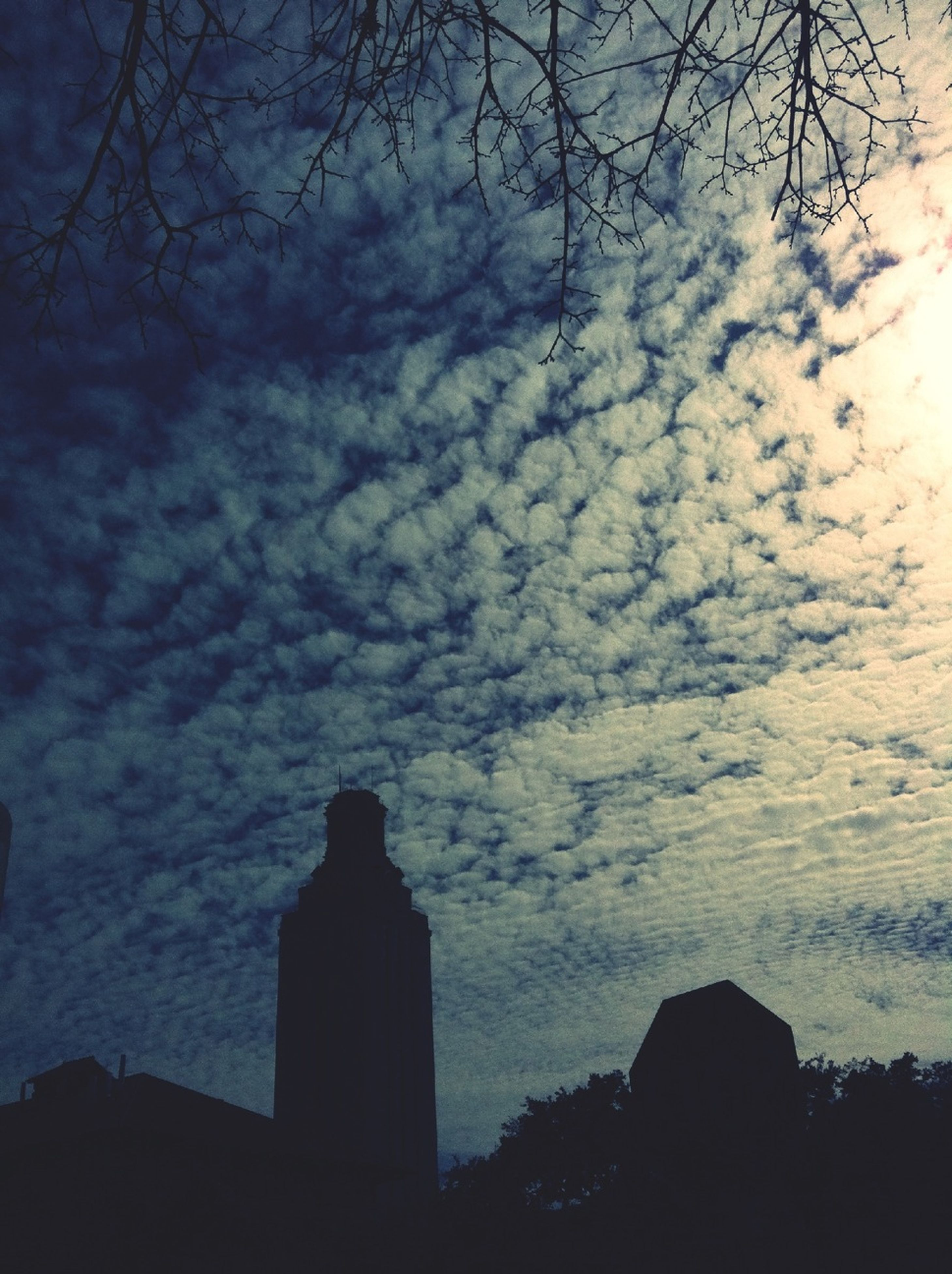 silhouette, sky, cloud - sky, architecture, built structure, building exterior, tree, cloudy, low angle view, dusk, cloud, sunset, nature, tranquility, beauty in nature, scenics, weather, bare tree, outdoors, tranquil scene