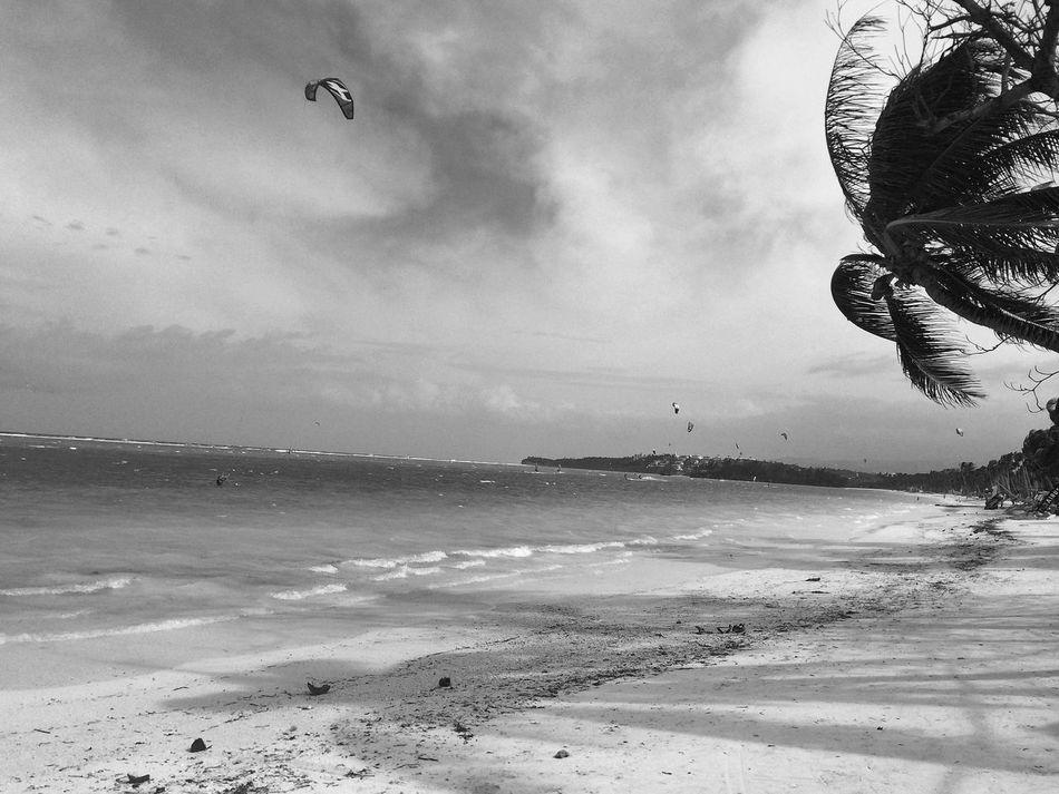 Kitesurfing day. Being A Beach Bum Enjoying The Sun Cloud And Sky