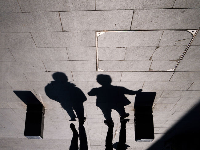 Day Focus On Shadow High Angle View Leisure Activity Lifestyles Men Outdoors People Real People Shadow Silhouette Standing Sunlight Togetherness Two People