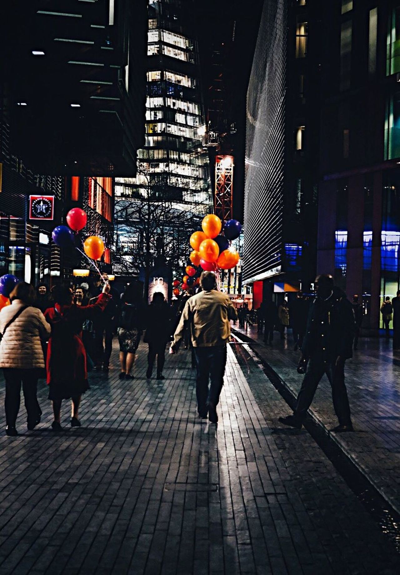 EyeEm LOST IN London The Shard The Shard, London Man with Balloons Nightphotography Night Photography Balloons London Architecture City Built Structure Illuminated Night Building Exterior Street Men Large Group Of People City Life Outdoors Women Standing Lifestyles Real People Pedestrian Adult People