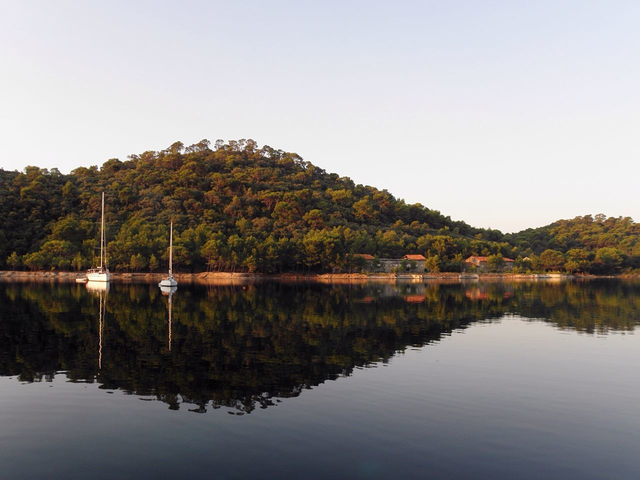 Reflection Water Nature Tree Croatia Scenics Outdoors Tranquil Scene Tranquility Day Sea Seascape Copy Space Mirror Calm Water Calm Sea Sailing Boat Sailing Harbour View Harbor Beauty In Nature Idyllic Waterfront No People Sky