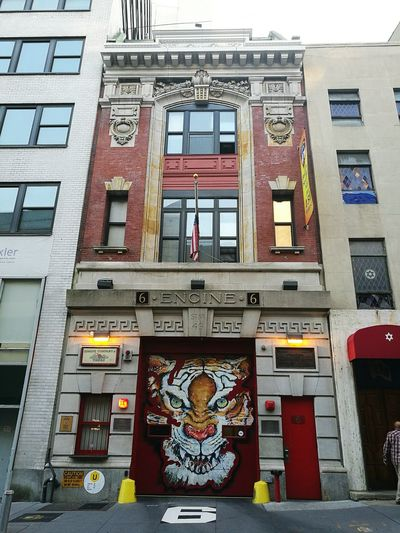 New York Fire House New York City New York Day Outdoors Multi Colored Creativity Art And Craft Downtown District Cityscape Low Angle View Travel Architecture City Cultures History Fire House Fire Engine Red Tiger Tiger Face Tiger Art