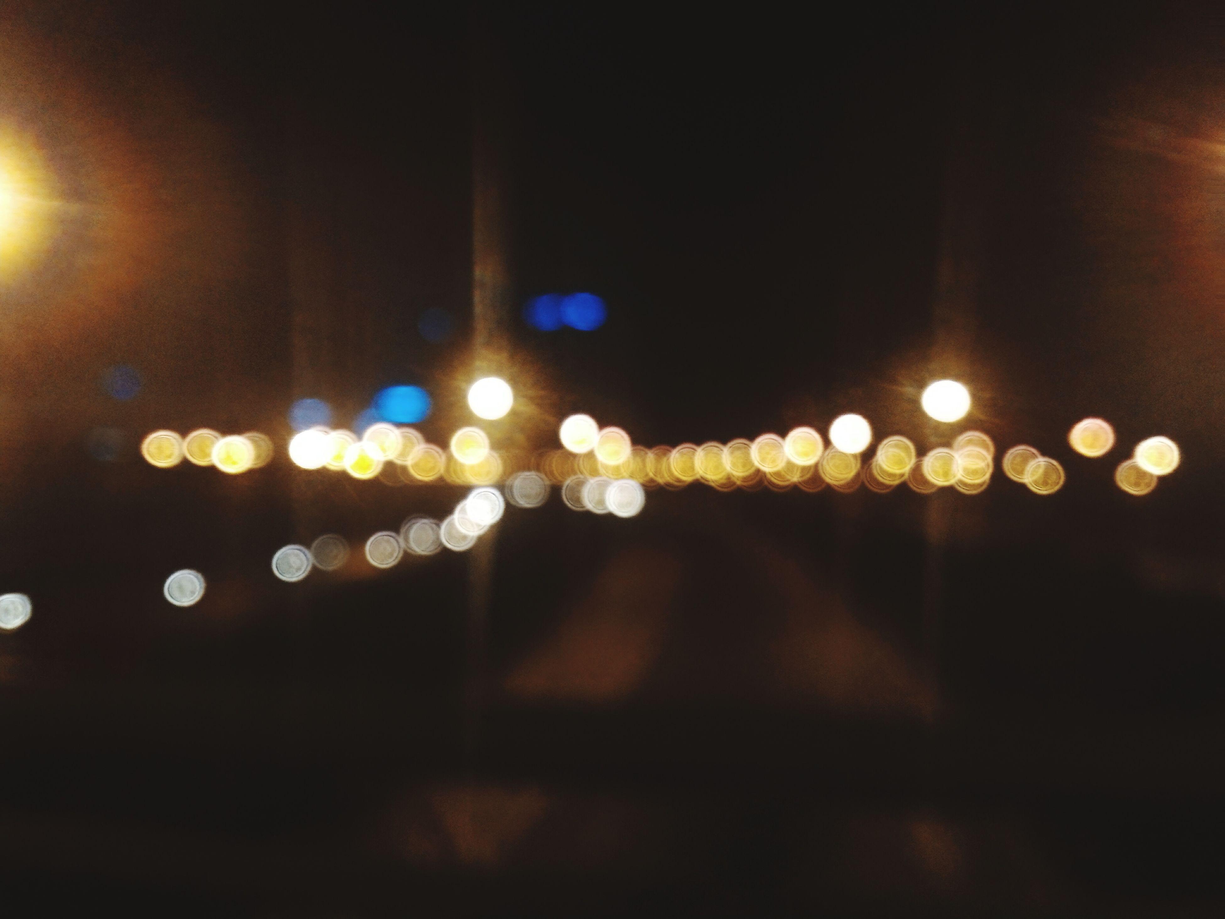 illuminated, night, lighting equipment, defocused, street light, light - natural phenomenon, city, street, architecture, built structure, glowing, lens flare, multi colored, electric light, transportation, building exterior, light, no people, indoors, window