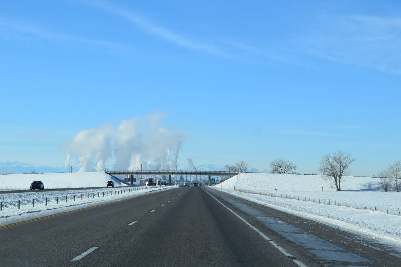 Beauty In Nature Bridge Cold Temperature Day Energy Gas Nature No People Oil Oil Refinery Outdoors Pollution Refinery Road Sky Smoke Snow The Way Forward Transportation Tree