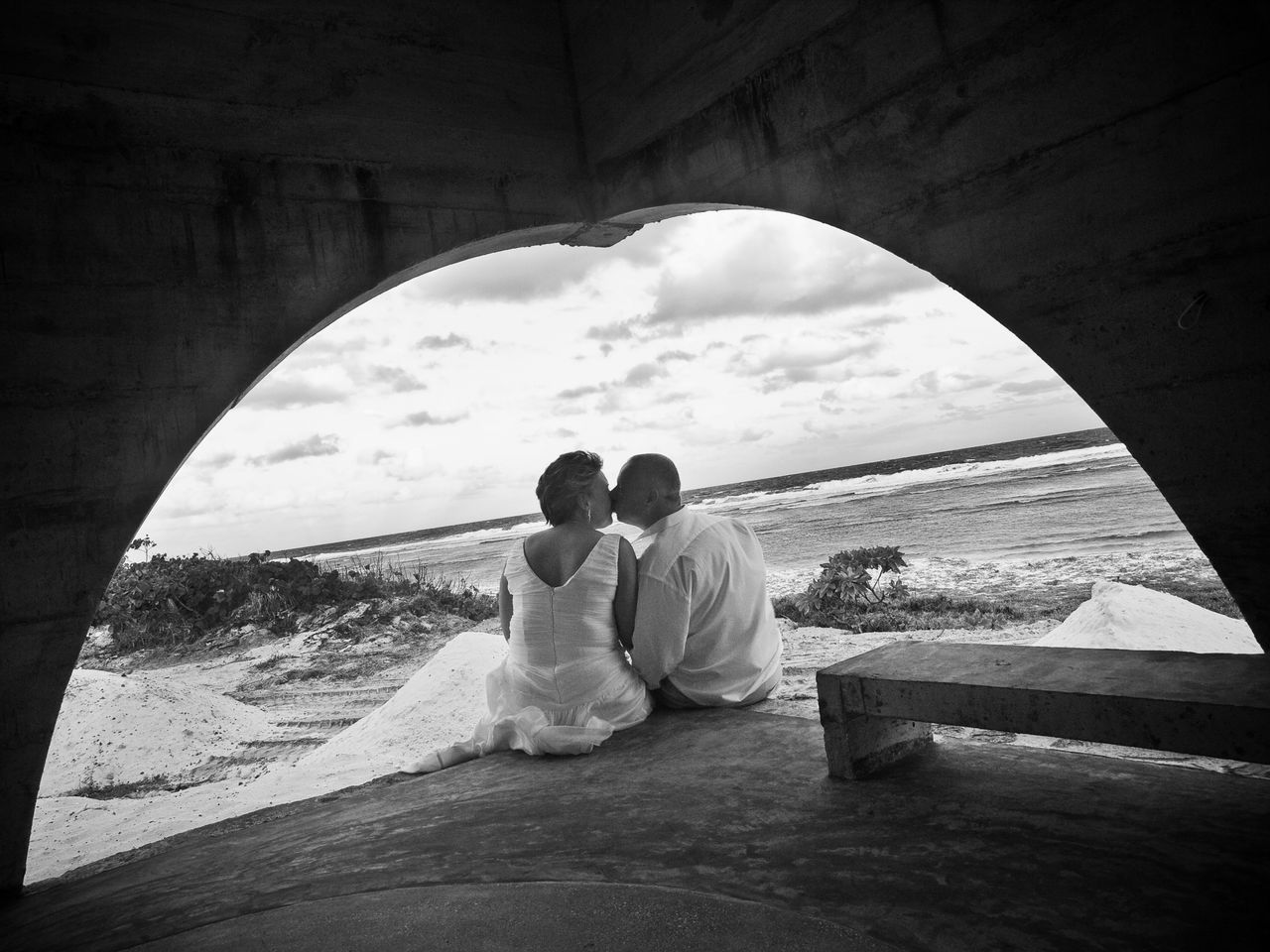 love, bride, two people, togetherness, wedding dress, rear view, sea, real people, wedding, romance, bonding, heterosexual couple, bridegroom, men, couple - relationship, women, sitting, beach, day, lifestyles, groom, nature, water, married, indoors, young women, sky, young adult, adult, adults only, people