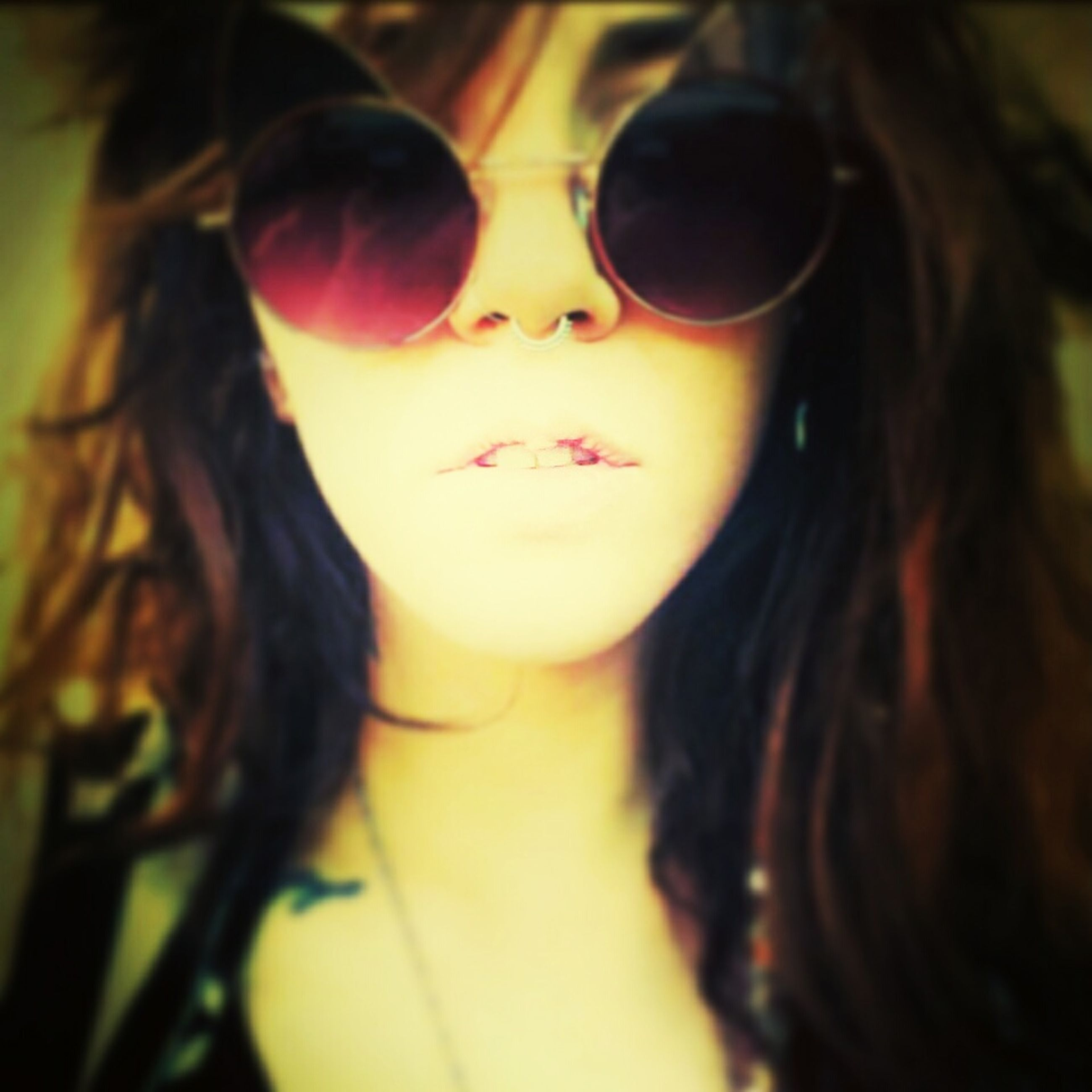 headshot, indoors, lifestyles, person, young adult, young women, close-up, looking at camera, leisure activity, portrait, long hair, focus on foreground, head and shoulders, front view, transportation, sunglasses, selective focus