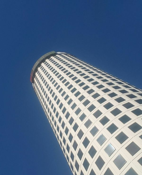 Modern Architecture Skyscraper Architectural Feature Business Finance And Industry Clear Sky City Building Exterior Blue Built Structure Sky Low Angle View Business Travel Destinations Day Corporate Business No People Outdoors
