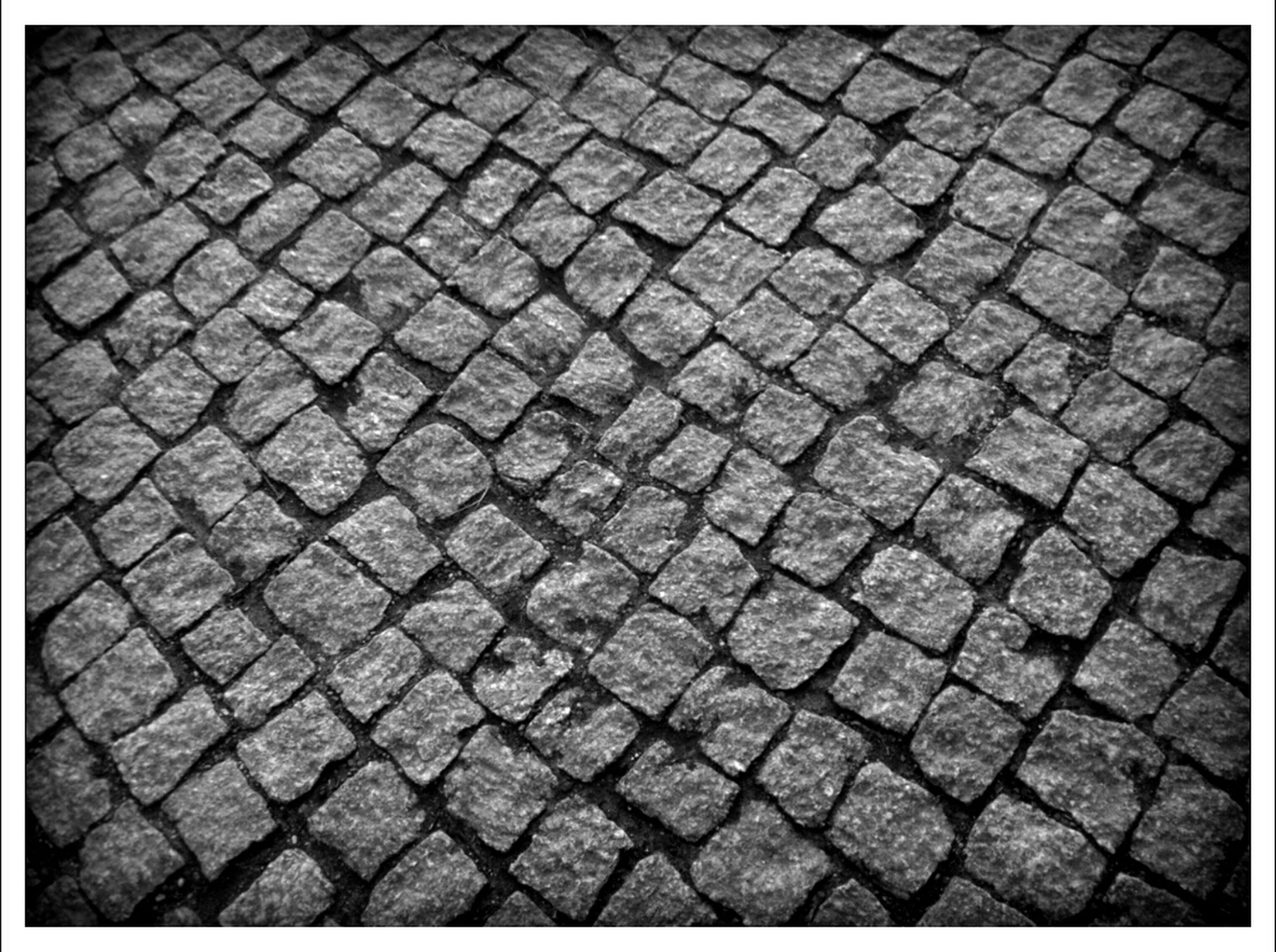 transfer print, cobblestone, auto post production filter, full frame, high angle view, pattern, backgrounds, paving stone, textured, street, footpath, outdoors, day, no people, ground, repetition, pavement, close-up, sidewalk, sunlight
