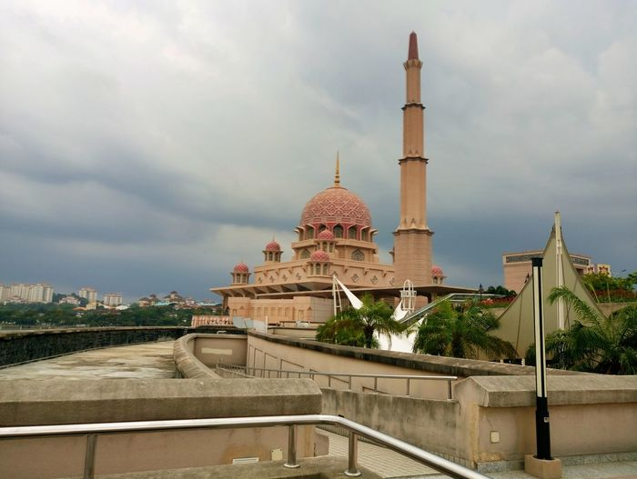 Masjid putrajaya on a cloudy day Cloud - Sky Outdoors Landscape Day Architecture Travel Destinations Religion Dome Sky Built Structure No People Scenics
