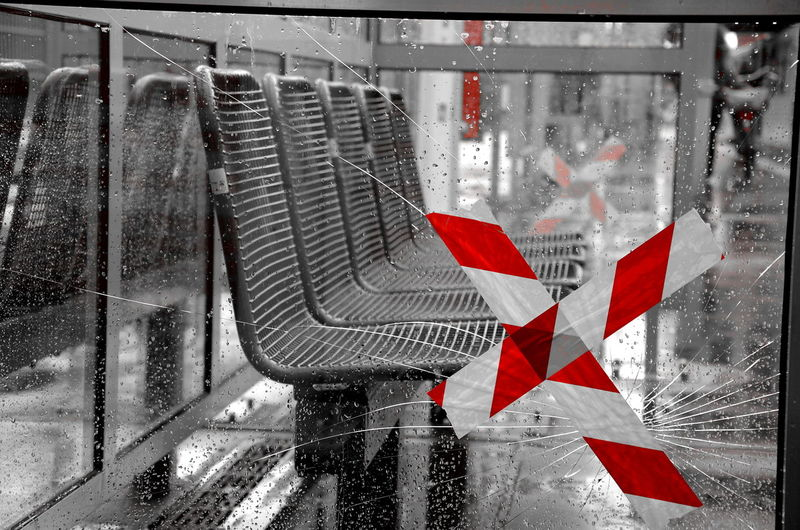 Injured Streetphotography Ubahn Berlin Oberbaumbrücke Art Is Everywhere Berlin Photography The Street Photographer - 2017 EyeEm Awards Berlin Black & White Blackwhitecolor No People Rainy Days Pavement Sticking Plaster Cross Red Cross Broken Glass Close-up Shelter Blackwhitecolour Discover Berlin Caution Tape Caution Caution ⚠️ Art Photography