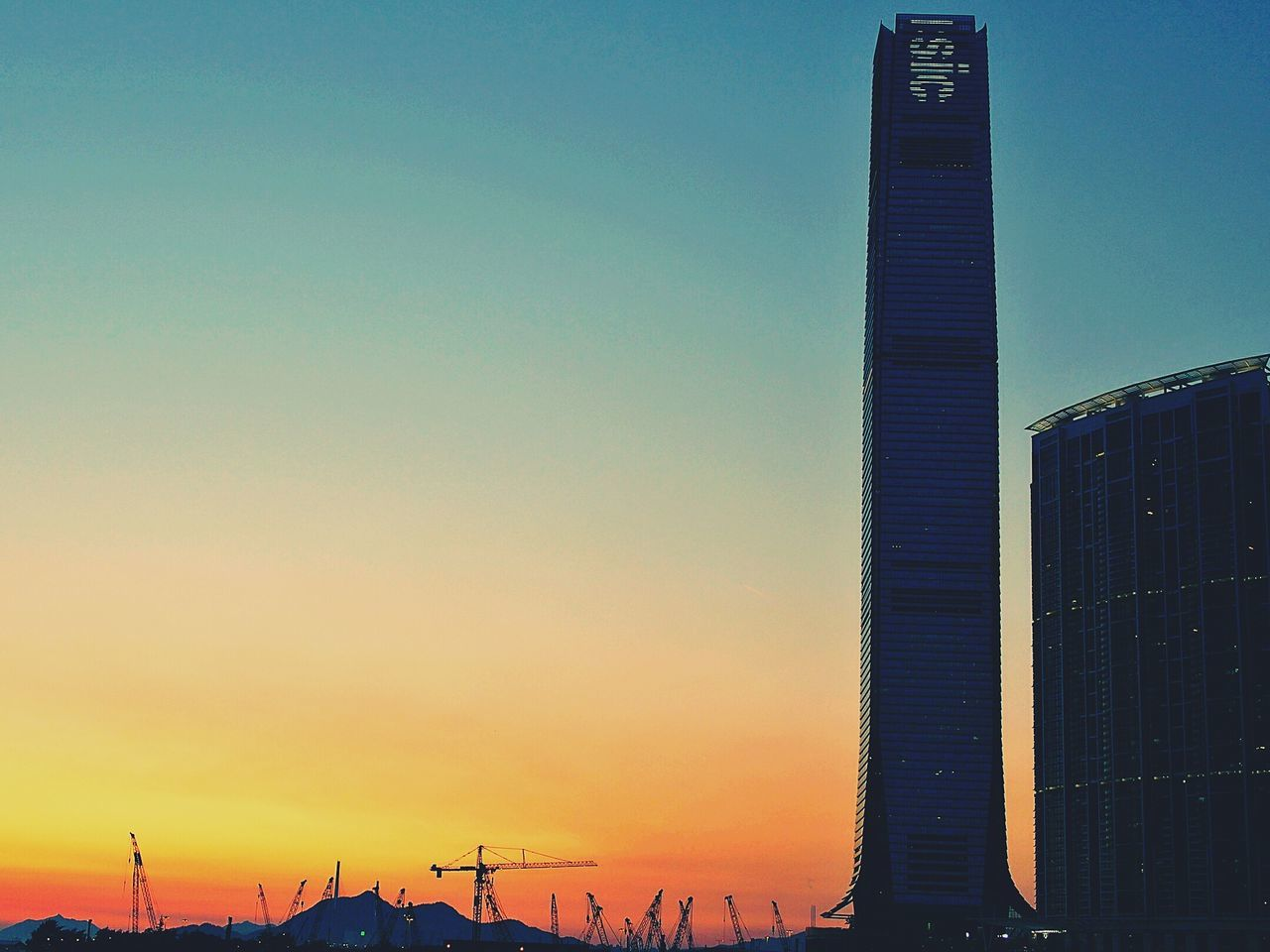 Sky 100 HongKong Landmark In Sunset