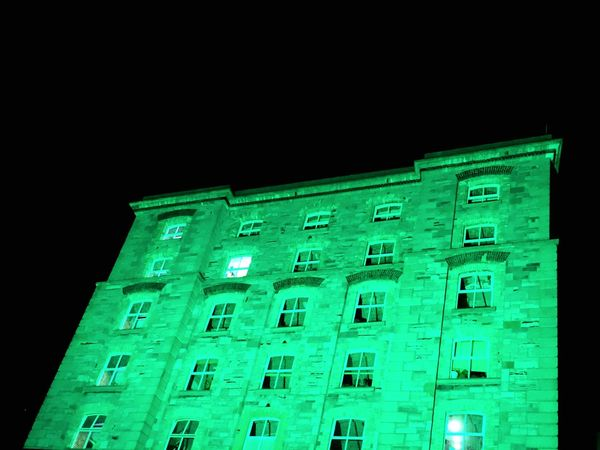 Low Angle View Architecture Illuminated Window Building Exterior Night No People Green Color Outdoors Black Background Sky