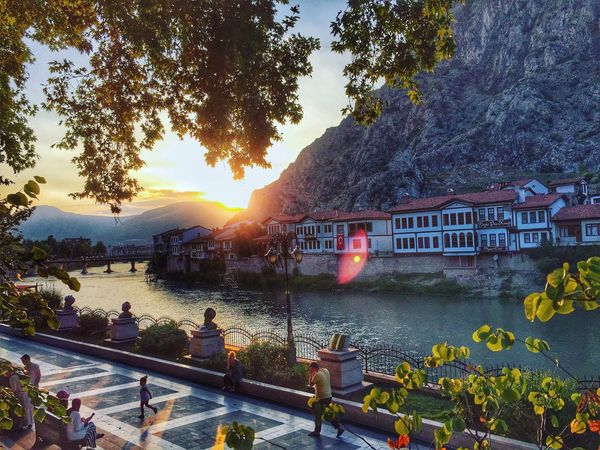 A sunset view from Amasya. Tree Architecture Built Structure Building Exterior Mountain Sunset Sun Road House River Travel Destinations Water Sky Canal Sunbeam Branch Mountain Range Scenics Riverbank Lens Flare