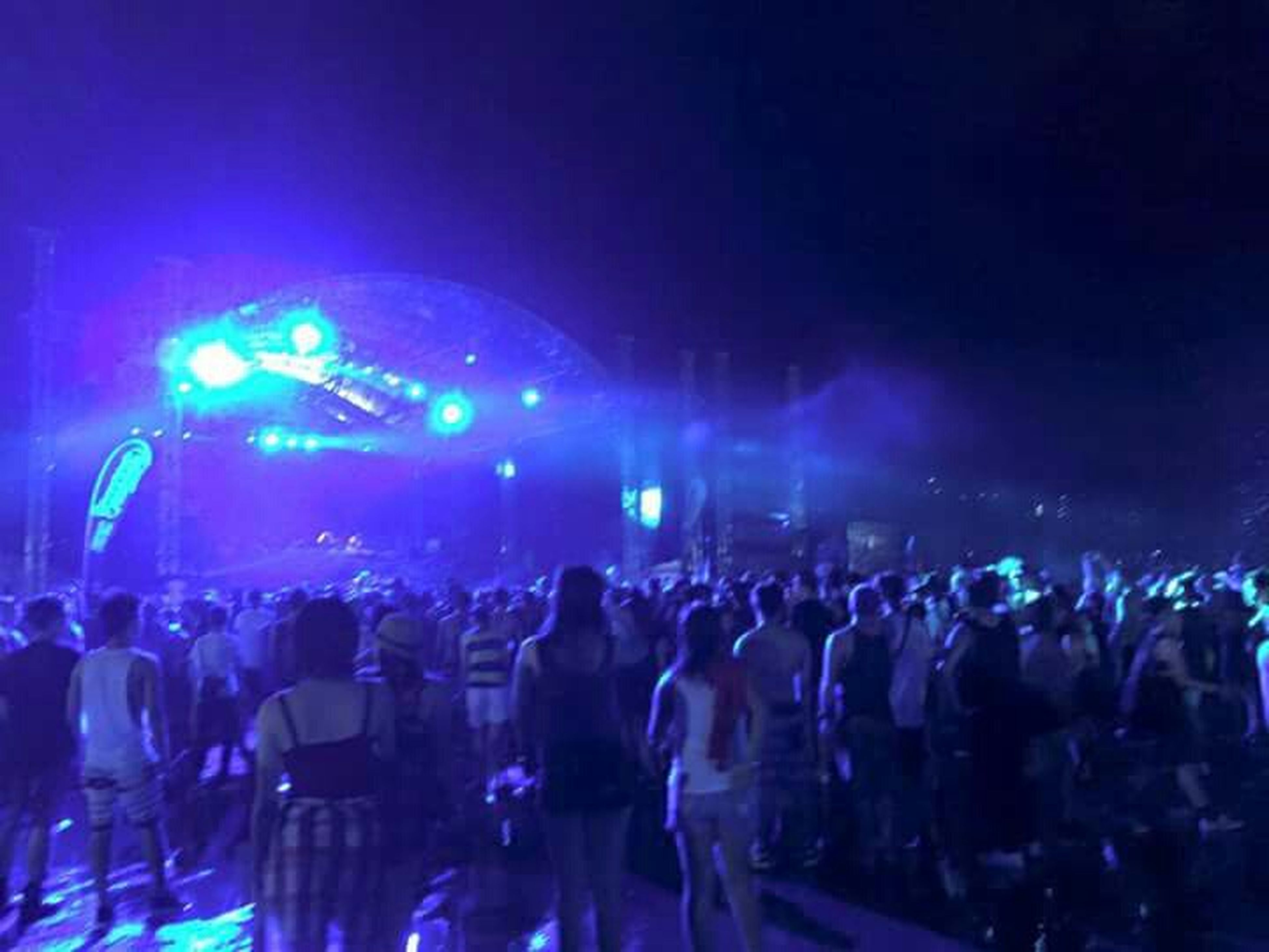 illuminated, large group of people, night, crowd, arts culture and entertainment, music, nightlife, men, lifestyles, person, enjoyment, leisure activity, performance, concert, music festival, event, stage - performance space, fun