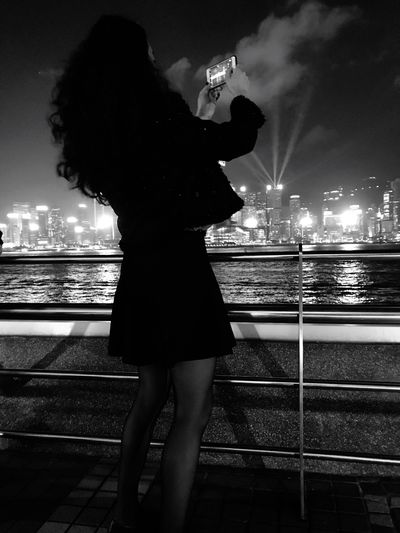 The Week On EyeEm Black And White Friday One Young Woman Only City Nautical Vessel Young Adult Building Exterior Young Women Full Length Lifestyles River Rear View Outdoors Leisure Activity Standing Illuminated Women Sky One Person Water Night Real People Fashion Stories An Eye For Travel