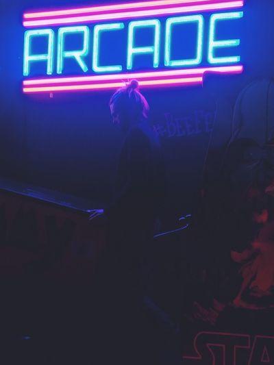 One Person Neon Indoors  Lifestyles Illuminated Arcade Retro Styled