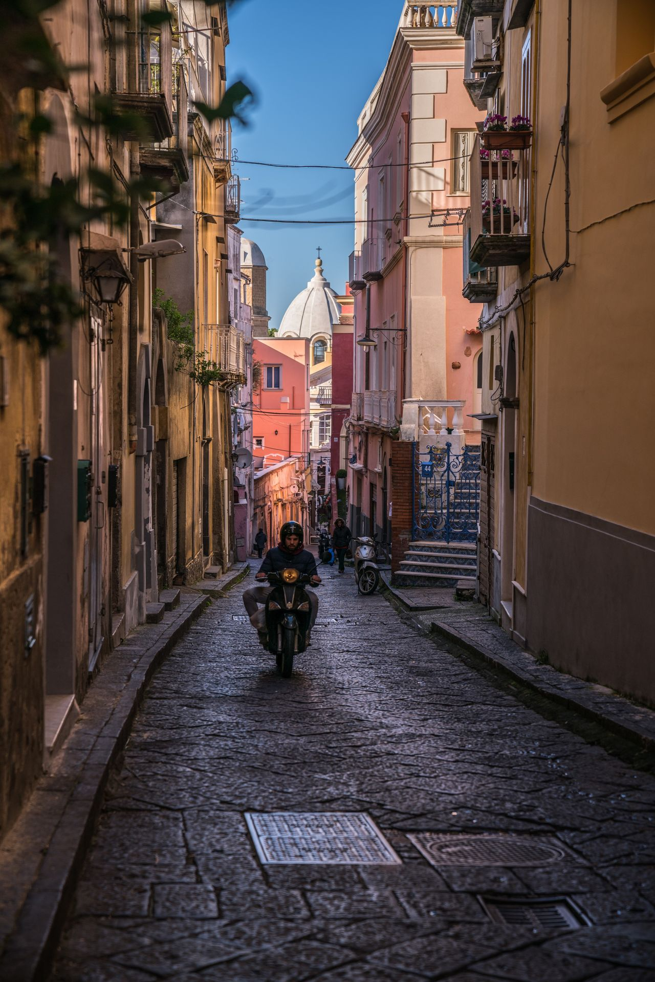 On the road again. Building Exterior Architecture Built Structure City Outdoors The Way Forward Day Vespa Procida Naples Napoli Bella Italia Italy Italia Italy❤️ Colorful Colors Cobblestone People People Watching Travel Destinations Streetphotography Street Travel Photography Travel