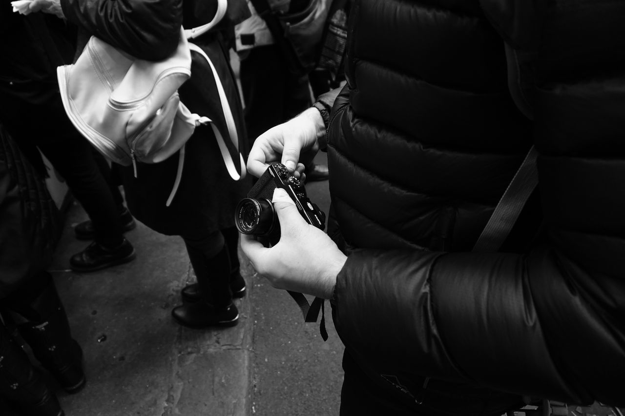Anticipating // Sony a6000 // Real People Holding Human Hand Camera Photographer Black & White Blackandwhite Market Lense London This Week On Eyeem Sony A6000 Lieblingsteil