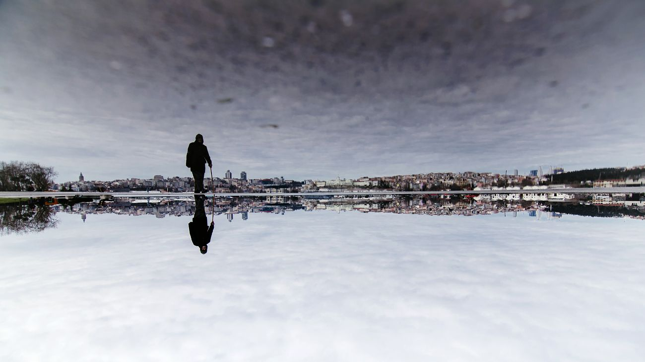 Reflection Symmetry Cloud - Sky Reflection Lake Landscape Outdoors Photography Eyeemphotography EyeEm Streetphotography One Person Sky One Man Only City Photographie  Street Photography