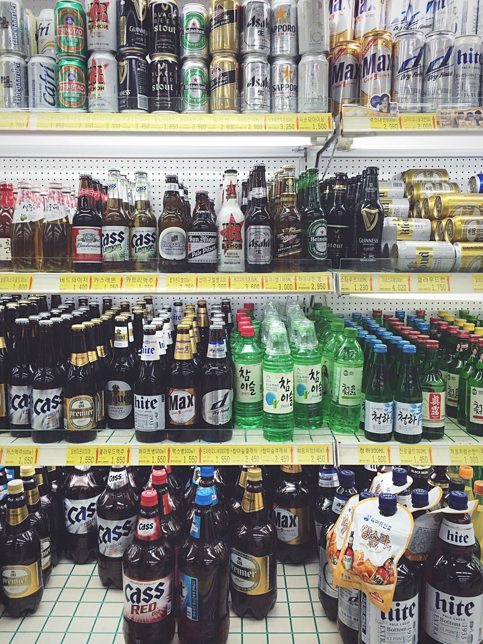 large group of objects, variation, abundance, choice, for sale, in a row, order, shelf, bottle, retail, arrangement, indoors, no people, multi colored, text, store, food and drink, drink, price tag, alcohol, food, day, freshness, supermarket
