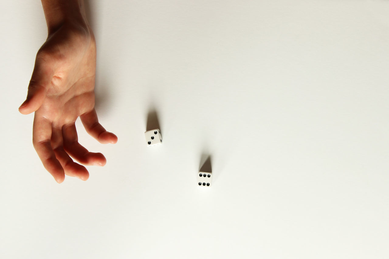 Roll the dice Gambling Games Hands RISK Recreation  Skill  Chance Concept Dice Directly Above Female Human Hand Idiom Lifestyles One Person Real People Roll The Dice White Background