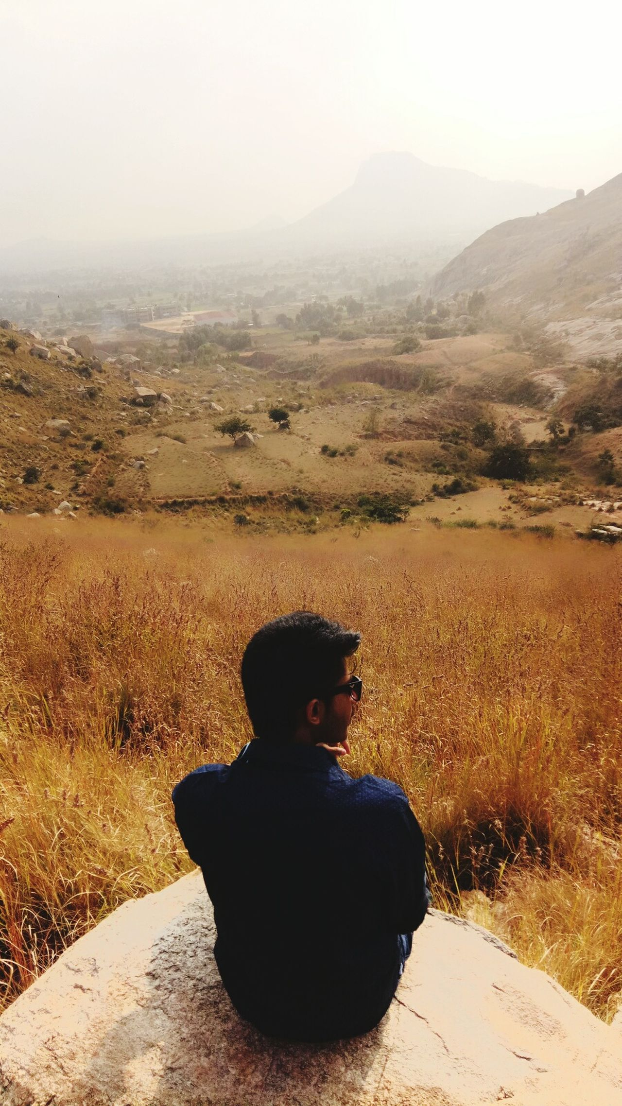Place where we can find ourselves... Rear View Sitting One Person Adventure Landscape Outdoors Mountain Day Nature One Man Only Sky Goggles Mountain View Sitting Grassland Grassland Under Sunlight Sunshine ☀ Summertime