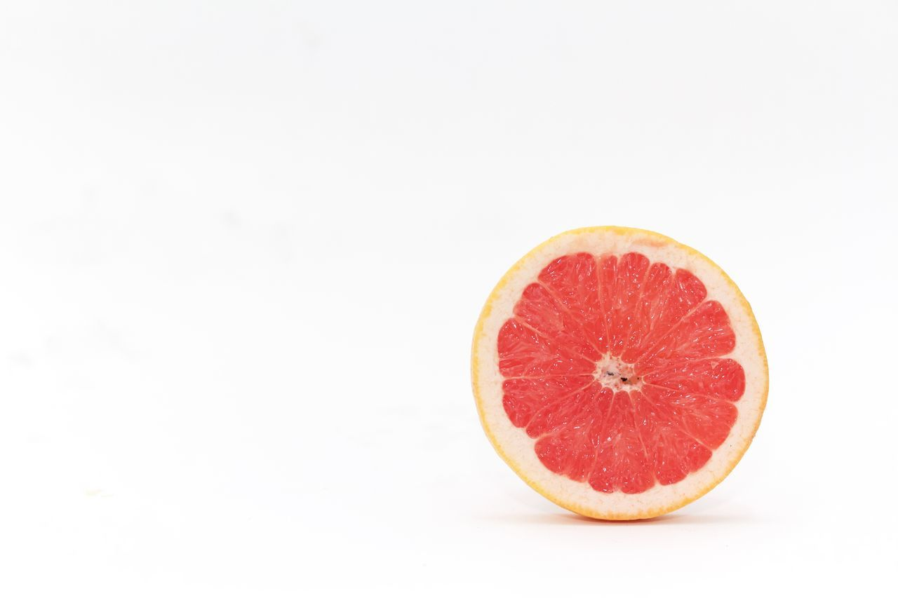 a slice of grapefruit in white background Citrus Fruit Close-up Food Food And Drink Freshness Fruit Grapefruit Healthy Eating Juicy No People SLICE Studio Shot White Background