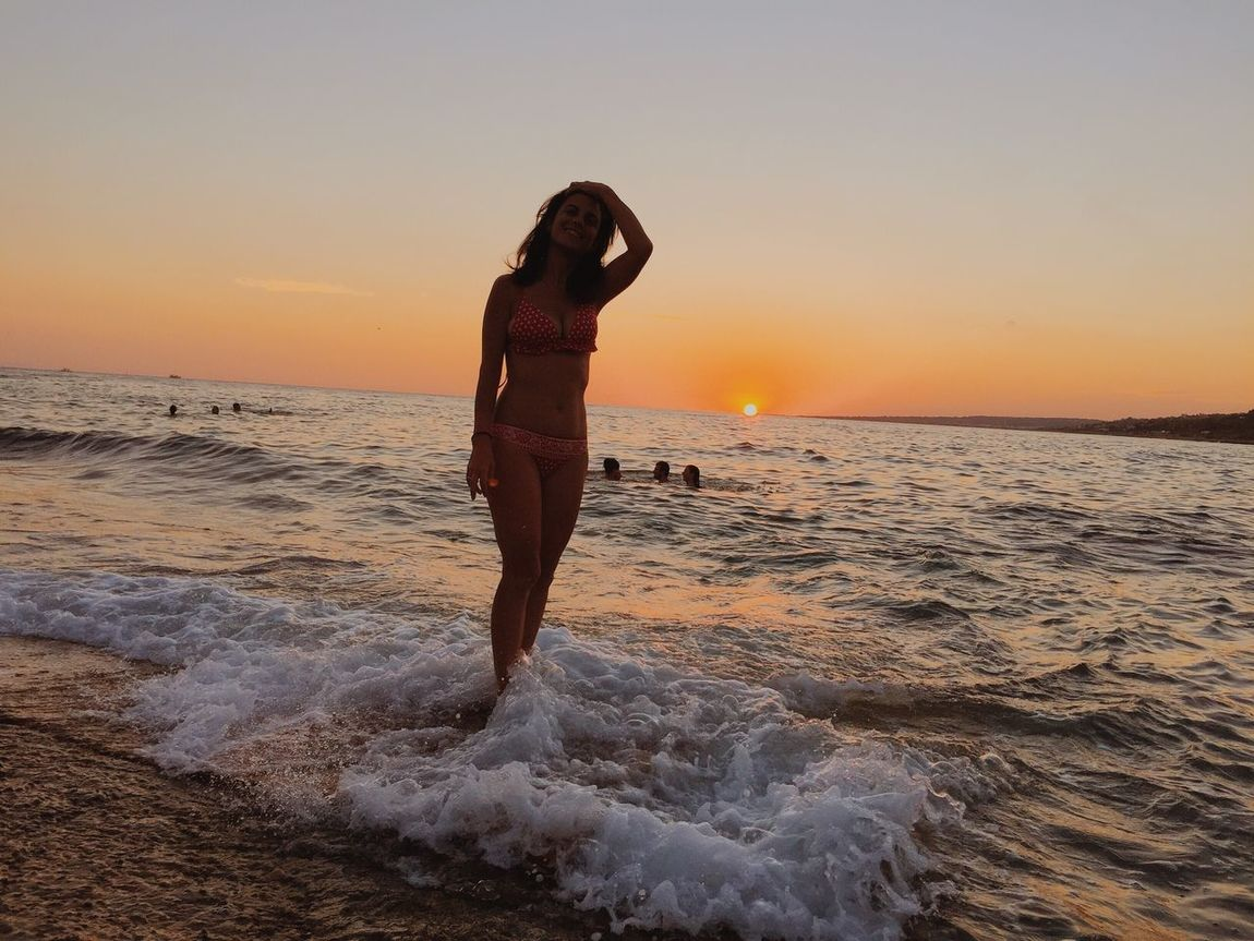 Live For The Story Sunset Sea Beach Orange Color Water Beauty In Nature Real People Scenics Nature One Person Sky Full Length Wave Horizon Over Water Sand Lifestyles Standing Leisure Activity Outdoors Clear Sky Sea Life Summer