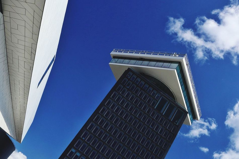 Low Angle View Architecture Built Structure Building Exterior Sky Blue Day Modern Cloud - Sky Outdoors No People Skyscraper City Modern Architecture Modern Building City Clear Sky Modern Architecture Modern Archictecture
