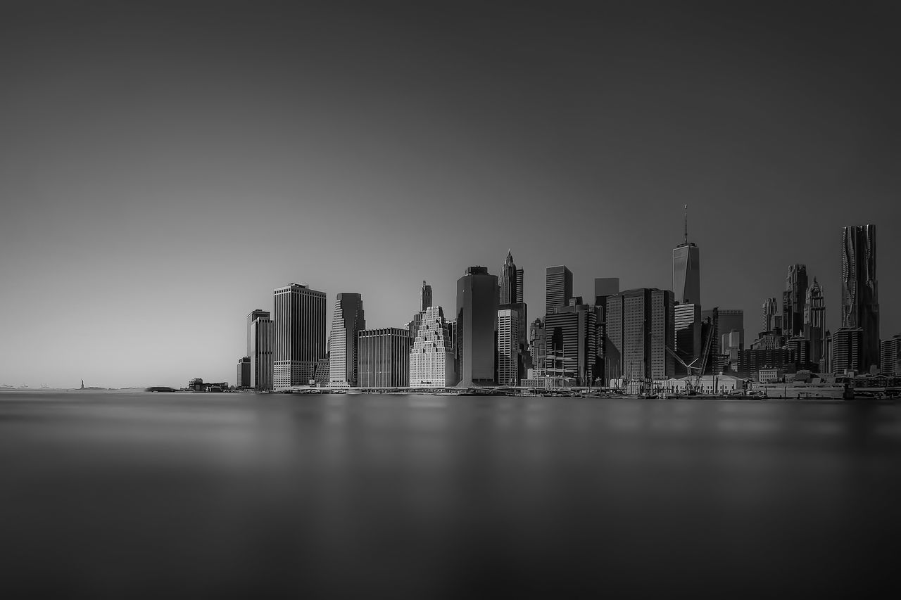 Architecture Black And White Built Structure Capital Cities  City City Life Cityscape Development Financial District  Illuminated Mid Distance Modern New York No People Office Building Outdoors Sky Skyline Tall Tall - High Tourism Tower Travel Destinations Urban Skyline Water