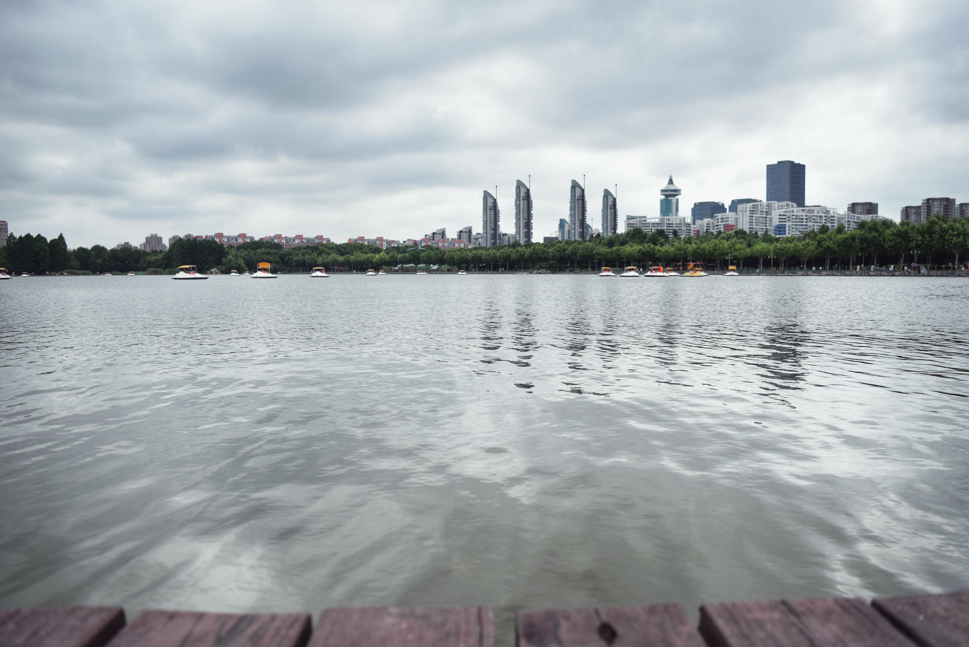 building exterior, water, architecture, built structure, sky, city, cloud - sky, sea, skyscraper, waterfront, cloudy, cityscape, cloud, river, urban skyline, tower, rippled, tall - high, modern, beach
