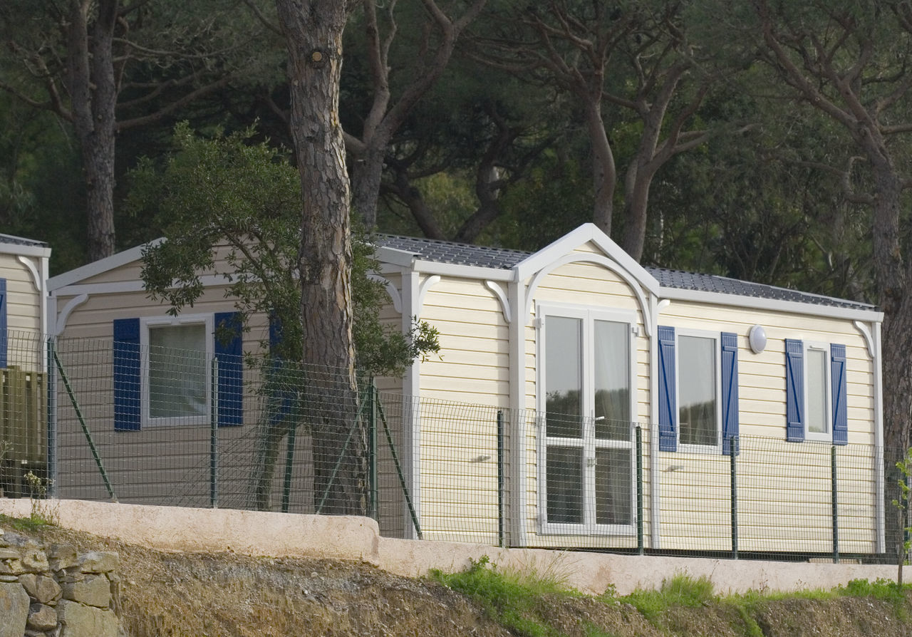 chalet in a holiday village - French Riviera Architecture Building Building Exterior Built Structure Camping Chalet Cottage Door Façade Forest France Front View Holiday Mobile Home No People RENT Rental Residential Building Tourism Tourist Resort Tree Village Window Woods Camp