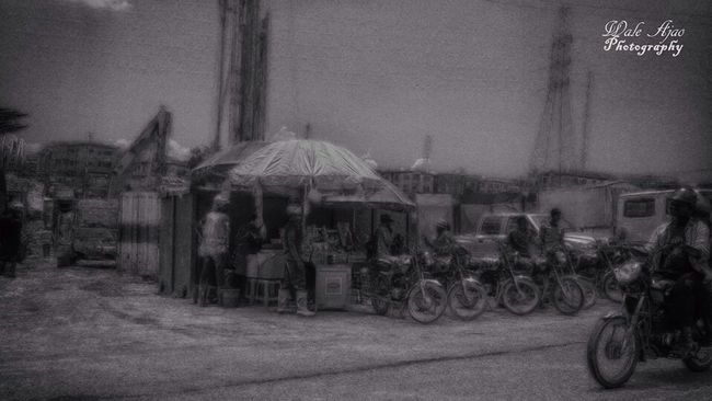 A trader, bike riders (okada riders as they are popularly known)and construction workers on the streets of Lagos, Nigeria. Project: Street Photography Series Photographer: Wale Ajao Location: Lagos, Nigeria #Street #StreetPhotography #Artistic #HDR #Photography #BlacknWhite #BlacknWhitePhotography #Photographer #PhotographersInLagos #PhotographersInNigeria #Project #PhotographyProject #PhotoStories #PhotoOfTheDay #WaleAjaoPhotography #WaleAjao Photooftheday Taking Photos Project PhotographyProject Photography Landscape #Nature #photography Blackandwhite Street Streetphotography Art Landscape HDR