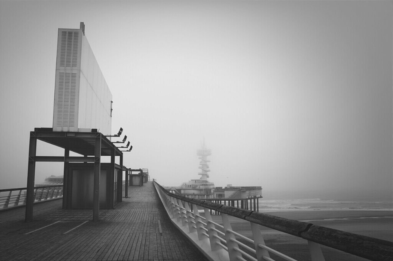 fog, sea, architecture, outdoors, water, no people, nature, day, sky