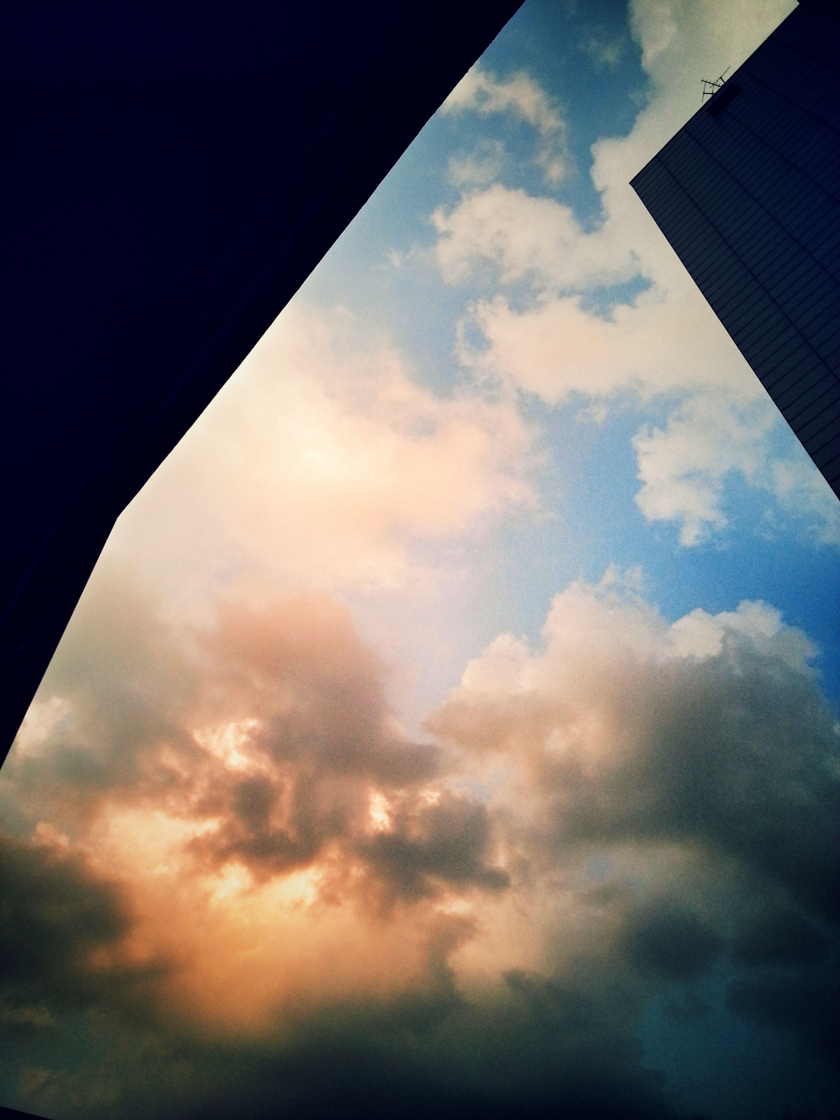 sky, low angle view, cloud - sky, architecture, built structure, cloud, building exterior, cloudy, sunset, silhouette, no people, cloudscape, outdoors, building, nature, city, dusk, directly below, sunlight, blue