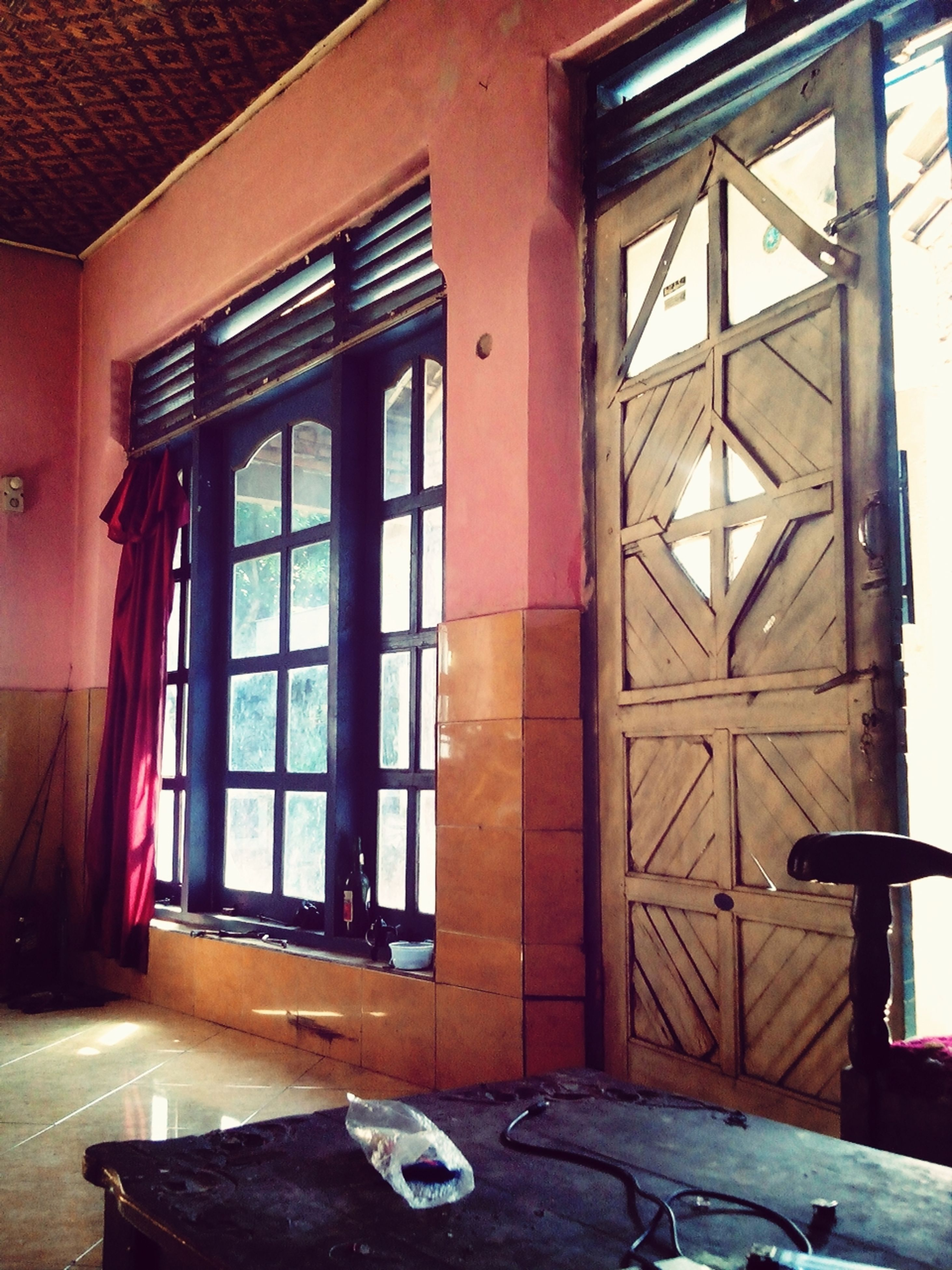 window, indoors, built structure, architecture, house, glass - material, door, abandoned, wood - material, building exterior, old, damaged, open, absence, closed, obsolete, day, table, no people, home interior