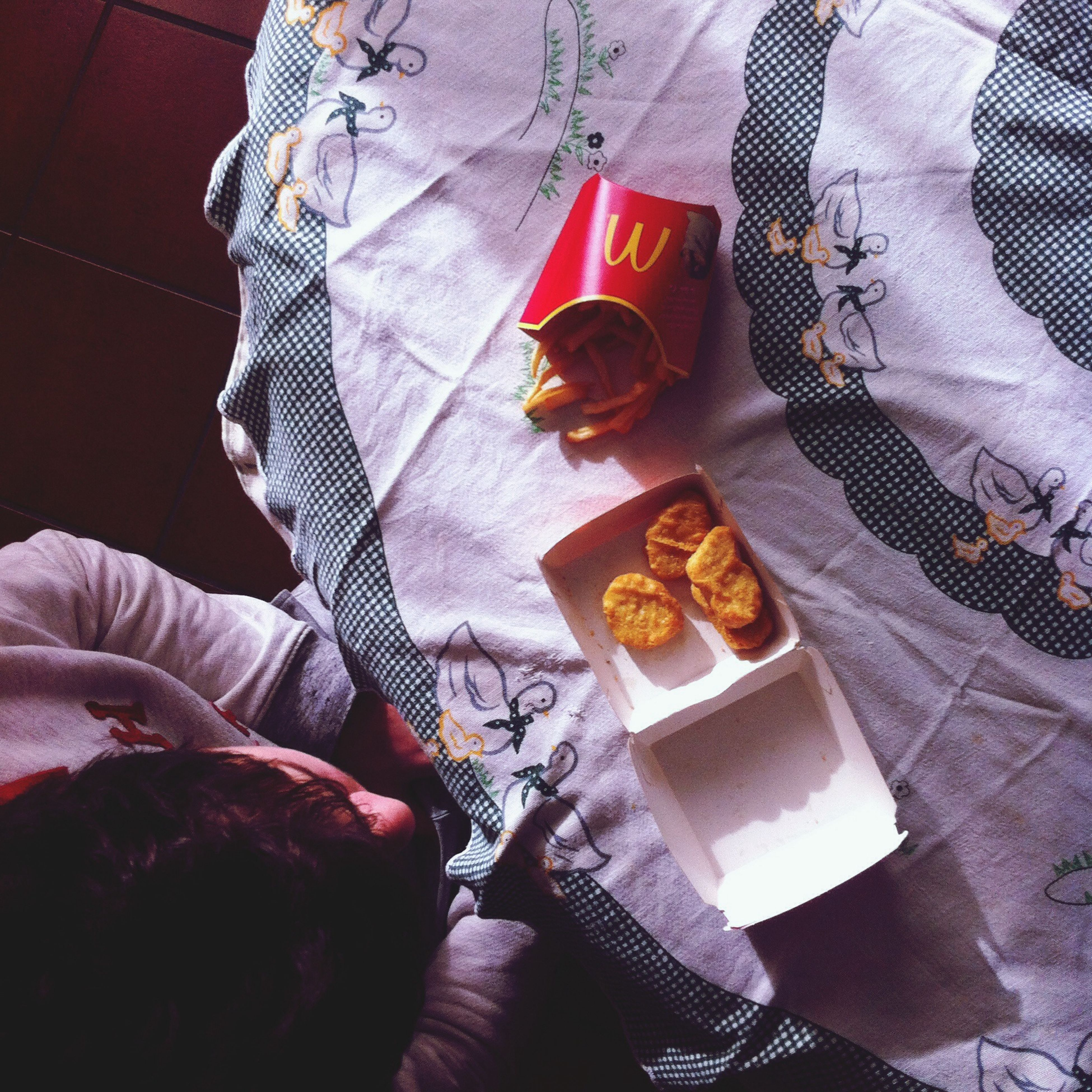 indoors, high angle view, food and drink, table, still life, food, paper, fabric, close-up, textile, red, day, bed, men, lifestyles, communication, freshness